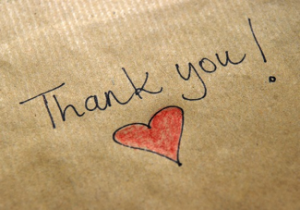 """brown paper with the words """"Thank You!"""" and a red heart handwritten on it describing Two Rivers Bank & Trust gratitude for their clients"""